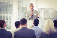 Businessman doing speech during meeting Stock Images