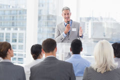Businessman doing speech during meeting Stock Photos