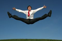 Businessman doing splits. In mid-air Stock Photos
