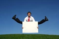 Businessman doing splits Stock Photo