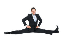Businessman Doing Splits Over White Background Stock Photos
