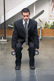 Businessman doing Squats Stock Images