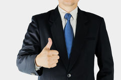 Businessman is doing thumps up sign over white background. Stock Photography