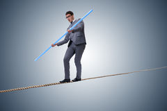 The businessman doing tightrope walking in risk concept Royalty Free Stock Photo