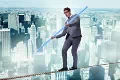 The businessman doing tightrope walking in risk concept Royalty Free Stock Images