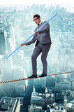 The businessman doing tightrope walking in risk concept Stock Image