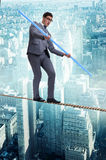 The businessman doing tightrope walking in risk concept Stock Images