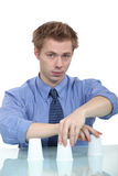 A businessman doing a trick. A businessman doing a cup trick Stock Photo