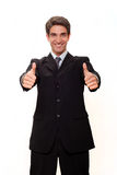 Businessman doing two thumbs up Royalty Free Stock Photos