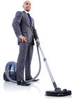 Businessman doing vacuum cleaning Stock Images