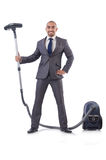 Businessman doing vacuum cleaning Stock Image