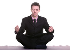 Businessman doing yoga Royalty Free Stock Images