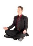 Businessman doing yoga. Royalty Free Stock Photography