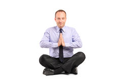 A businessman doing yoga exercise Royalty Free Stock Images