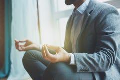 Businessman doing yoga stock photos