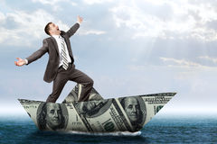 Businessman in dollar boat Royalty Free Stock Photography