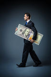 Businessman with dollar Stock Image