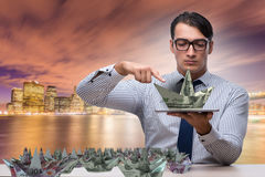 The businessman with dollar paper boats Royalty Free Stock Image