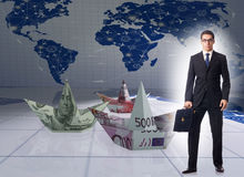 The businessman with dollar paper boats Royalty Free Stock Images