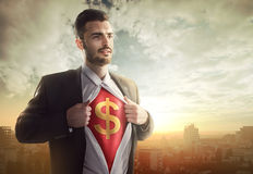 Businessman with dollar sign as superhero royalty free stock photography
