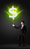 Businessman with a dollar sign balloon Royalty Free Stock Images
