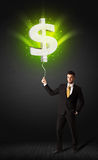 Businessman with a dollar sign balloon Stock Photo