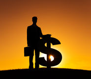 Businessman with Dollar Sign Currency Back Lit Stock Image