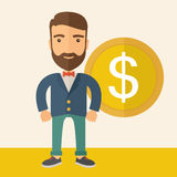 Businessman with dollar sign. A hipster Caucasian businessman with beard wearing blue jacket smiling while standing with dollar sign beside him showing that he Royalty Free Stock Image