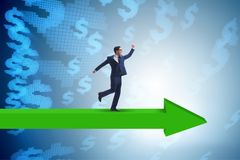The businessman with dollar walking on arrow sign. Businessman with dollar walking on arrow sign Stock Photography
