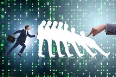The businessman in domino effect business concept Stock Photo