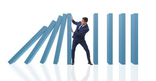 The businessman in domino effect business concept Royalty Free Stock Photos