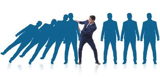 The businessman in domino effect business concept Stock Image