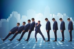 The businessman in domino effect business concept Stock Photography