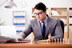 The businessman with dominoes in the office Royalty Free Stock Images