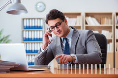 The businessman with dominoes in the office Royalty Free Stock Photo