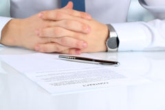 Businessman is doubting  about signing  a contract, business con Royalty Free Stock Photo
