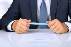 Businessman is doubting  about signing  a contract, business contract details Stock Photo