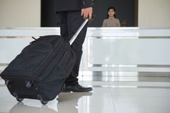 Free Businessman Drag Luggage Or Suitcase Walking To The Hotel Lobby Stock Image - 118315711