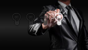 Businessman draw bulb, business strategy Stock Photo