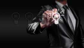 Businessman draw bulb, business strategy Stock Photo