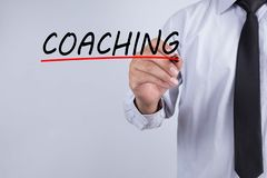 Businessman draw coaching word. Training Planning Learning Coaching Business Guide Instructor Leader concept royalty free stock image