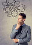 Businessman with draw gears over head Royalty Free Stock Images