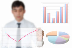 Businessman draw graph for year 2012 Royalty Free Stock Images