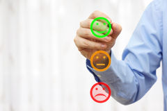 Businessman draw happy smiley icon on survey list, ready for sam Royalty Free Stock Images