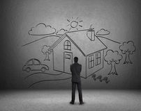 Businessman draw a house on wall Royalty Free Stock Photo