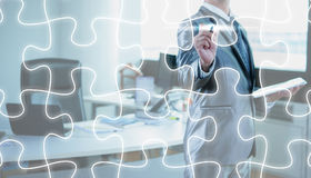 Businessman draw jigsaw line, business strategy Stock Photography