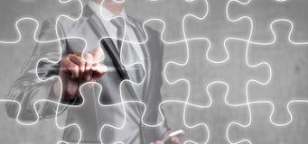 Businessman draw jigsaw line, business strategy Stock Photography