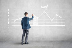 Businessman drawind growth chart and arrow on the Royalty Free Stock Images