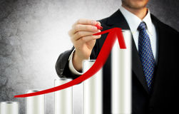 Businessman Drawing A Rising Arrow Royalty Free Stock Images