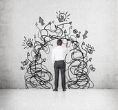 Businessman with drawing arrows a Stock Images